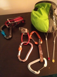 Left to Right: Belay devices, quick draw, stoppers, chalk bag.