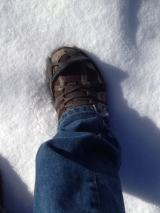 When putting on YakTrax you simply slip your toe in as you can see, and then stretch around to the heal shown right.